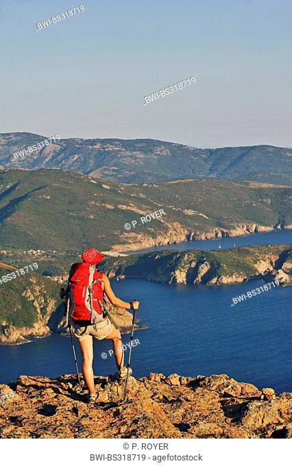 female wanderer enjoying the view to Corsians coast, France, Corsica, Capo Rosso