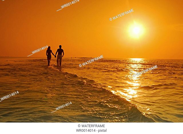 Couple at Sunset, Indian Ocean, Maldives