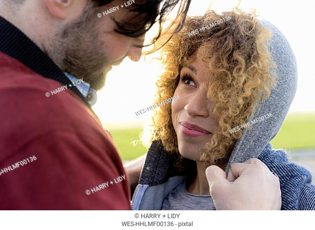 Portrait of smiling young couple close together outdoors