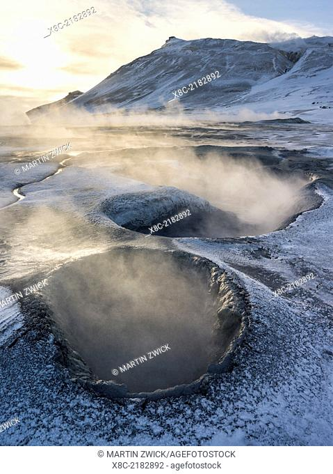 Geothermal area Hveraroend near lake Myvatn and the ring road during winter with mud pools , fumaroles and solfataras. europe, northern europe, scandinavia