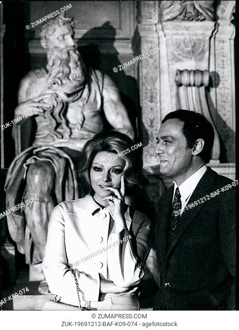 Dec. 12, 1969 - Sylva Koscina and Maurice Ronlt are turning in Rome some exterior scenes of the film 'The Modification' directed by Michel Worms and drawn by a...