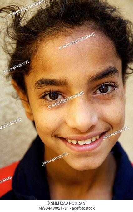 Aya, 12 year old, at Karitas centre for street children in Kafr El Sisi neighbourhood in Cairo She comes to Karitas centre with Shiriham, 6 year old, and Ola