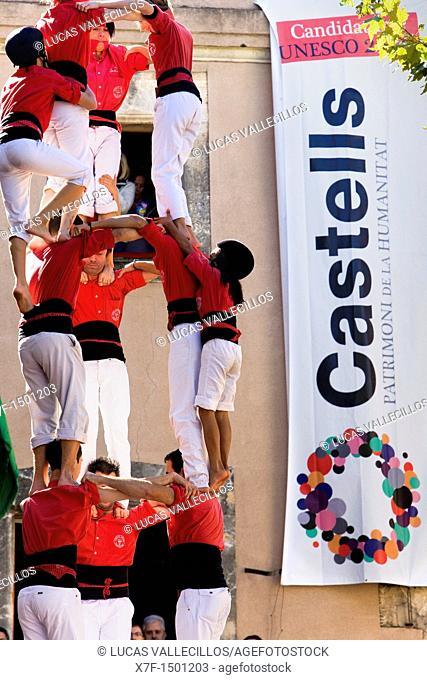Colla Joves Xiquets de Valls 'Castellers' building human tower, a Catalan tradition Fira de Santa Teresa, town festival  Plaça Vella El Vendrell Tarragona...