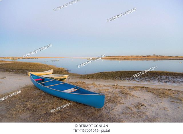 USA, Massachusetts, Cape Cod, Eastham, Blue canoe on beach