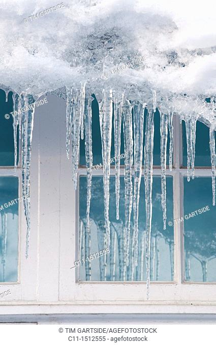 icicles on house,Winter snow, Kent, England, UK