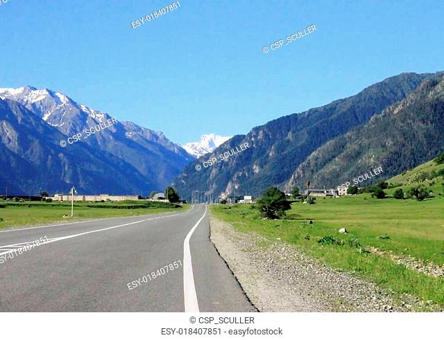 Road leading between the mountains. Caucasus travel