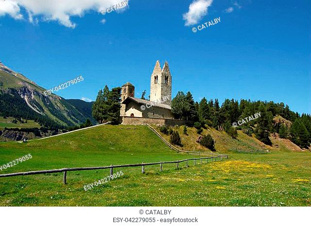 The ancient medieval church of San Gian (Saint John) in Celerina or Schlarigna, small village in Engadine, Switzerland, Europe