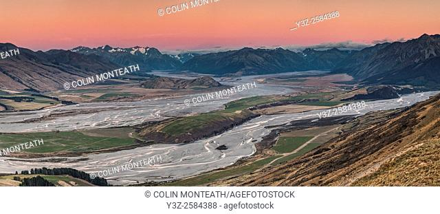 Pre-dawn alpenglow over braided river beds, confluence Wilberforce and Rakaia rivers, panorama from Mt Oakden, Canterbury