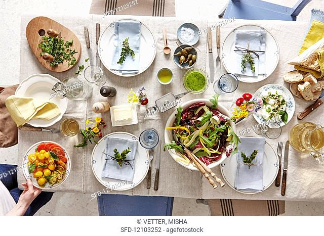 A set table with starters and salad
