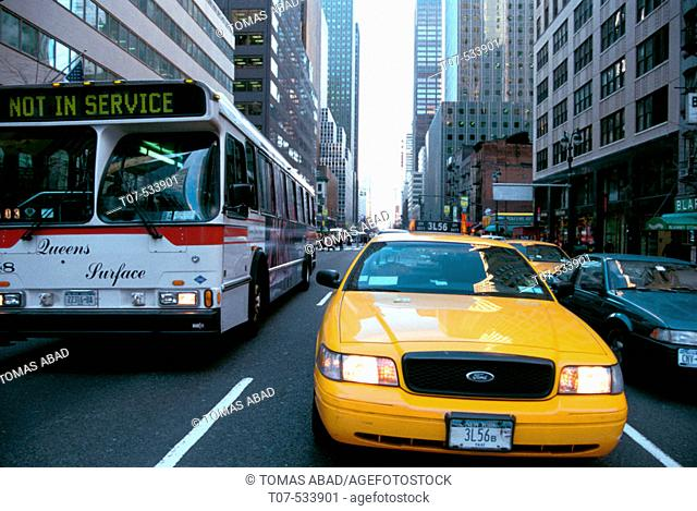 Taxi cab and public bus. Manhattan. New York City traffic. USA