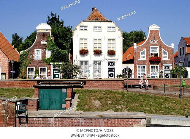 historic claddings from the 18th century at the harbour of Greetsiel, Germany, Lower Saxony, East Frisia