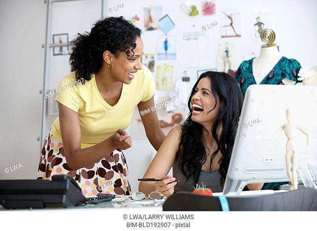 Businesswomen talking in design studio