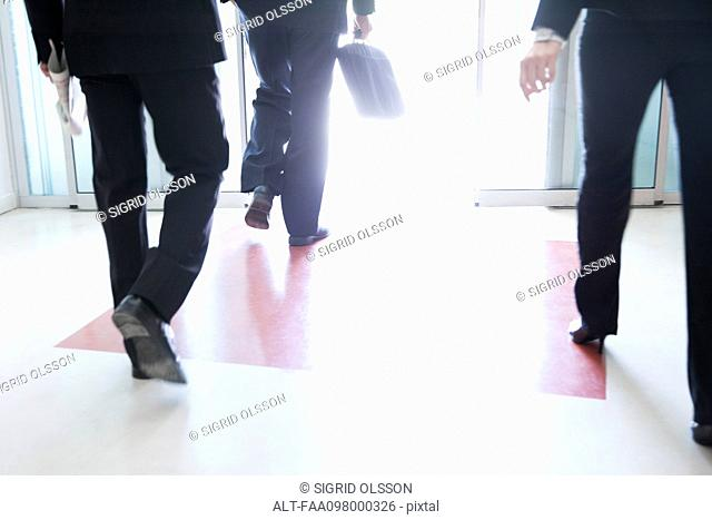 Business professionals exiting building