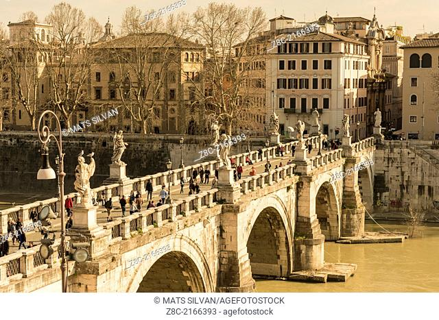 Bridge Sant'Angelo with statue over river Tiber in Rome Italy