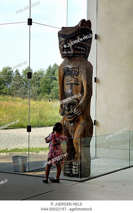 Totem poles and native art in Museum of Anthropology of Vancouver City , little girl in front of First Nations Totem pole , Canada, North America