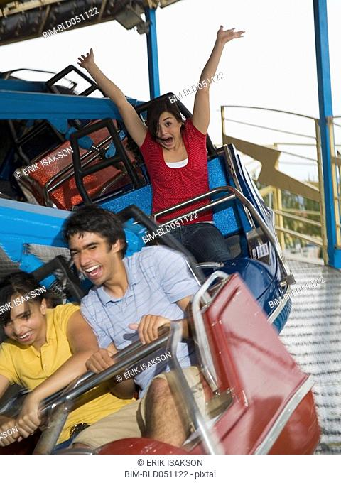 Multi-ethnic teenaged friends on carnival ride