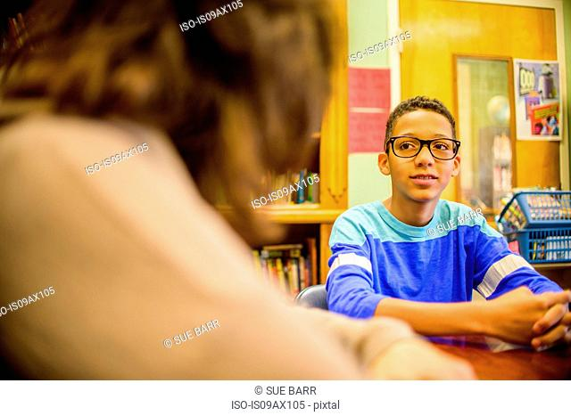 Teenage boy at school speaking to guidance counselor