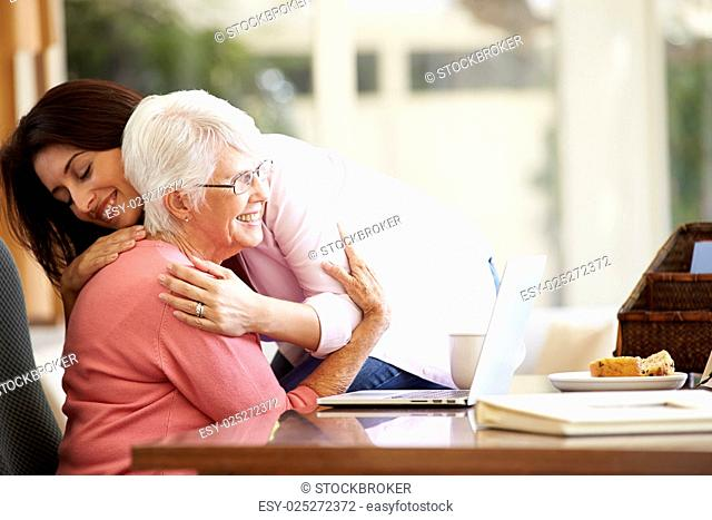 Senior Mother Being Comforted By Adult Daughter