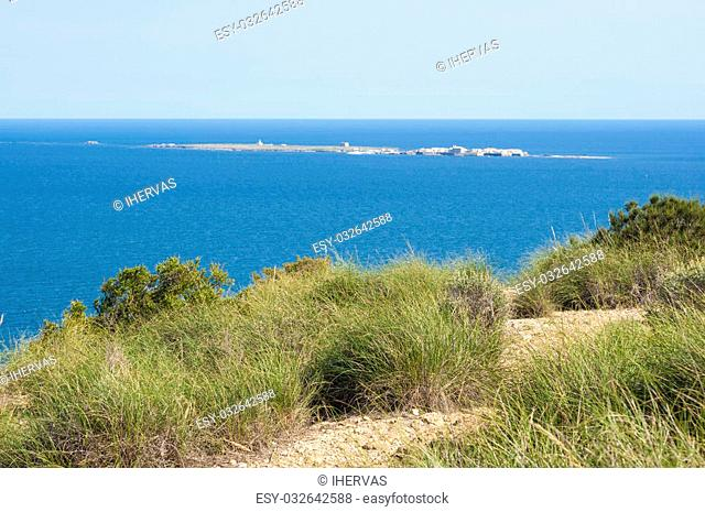 Views of Tabarca islet from Santa Pola town, Alicante, Spain. It is the smallest permanently inhabited islet in Spain