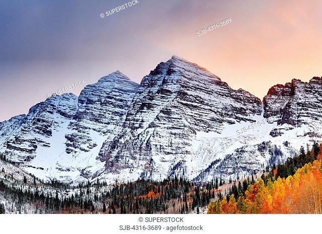 Maroon Peak, left, and North Maroon Peak, right, also known as The Maroon Bells, reflected in Maroon Lake. Maroon Peak is 14,163 feet, or 4