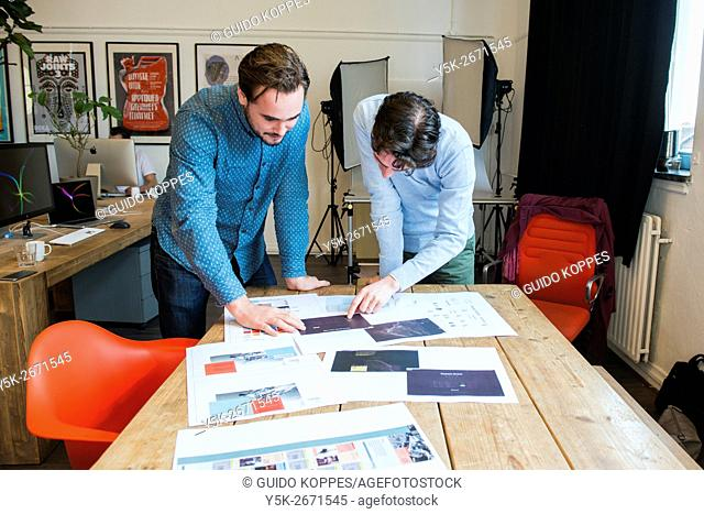 Utrecht, Netherlands. Two professional, creative males and artists explaining their work in the creation of the Hart Island Project website