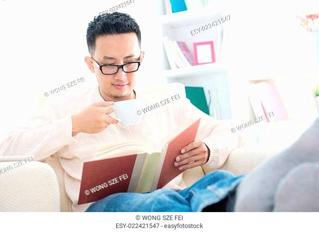 Southeast Asian male reading a book