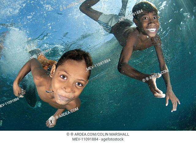 Underwater boys playing