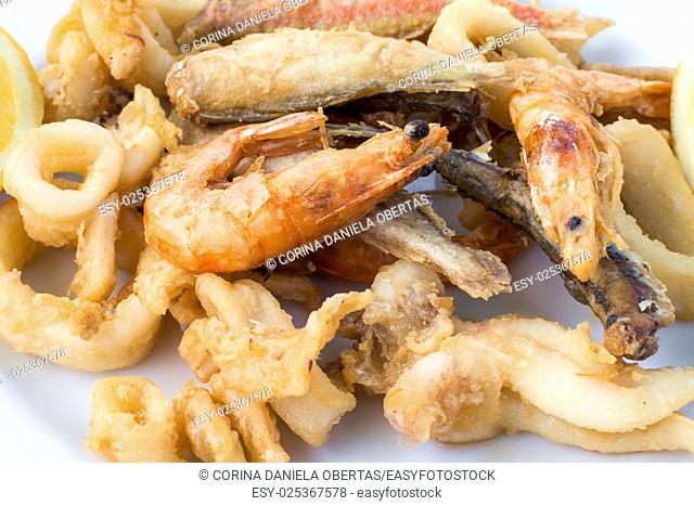 Plate with fried seafood, typical recipe of the Italian cuisine