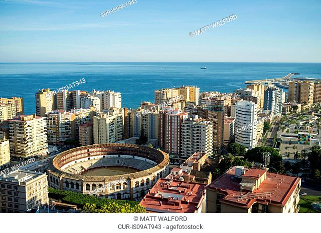 High angle view of bullring and skyscrapers, Malaga, Spain
