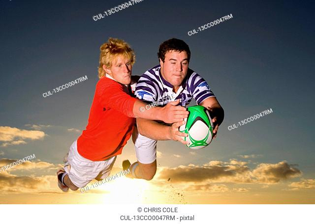 Rugby Tackle at Sunset