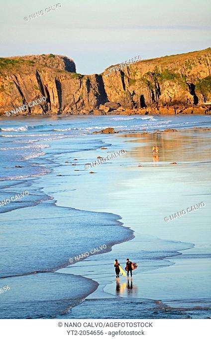 Surfers on San Antolin beach, Llanes, Asturias