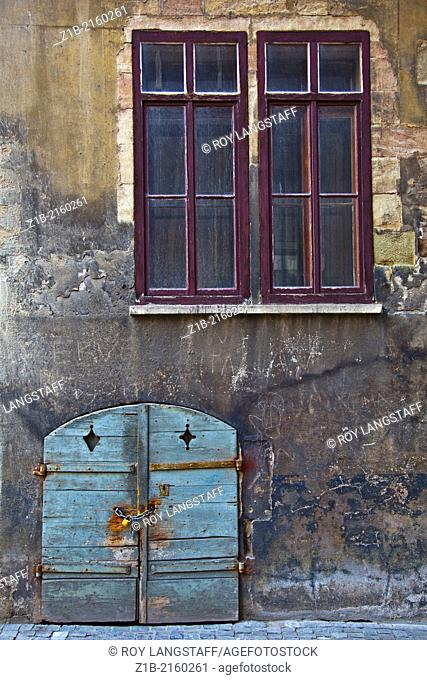 A cellar entry door in a side alley of Geneva's old town, Switzerland