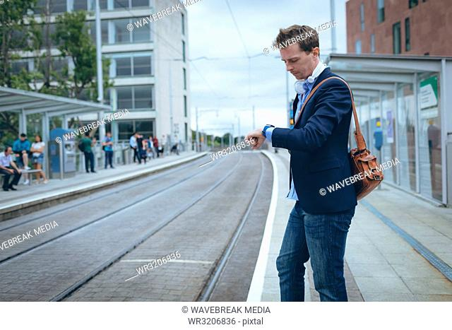 Businessman checking time in his smartwatch