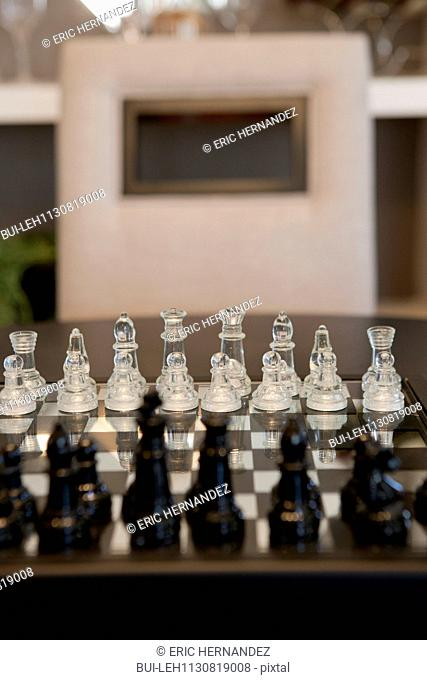 Focus on white chess pieces on chessboard
