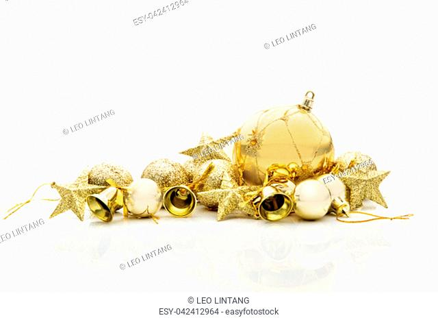 Close up view of christmas ornaments with golden color isolated over white background