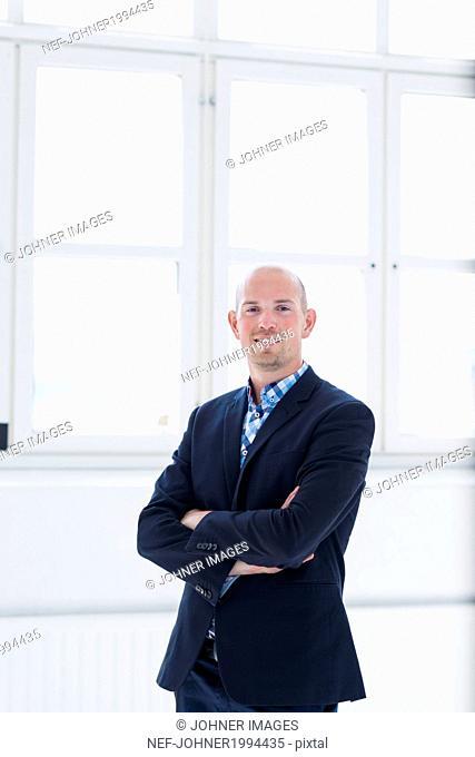 Smiling man wearing jacket