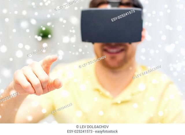 technology, augmented reality, entertainment and people concept - close up of happy young man with virtual headset or 3d glasses playing game at home over snow
