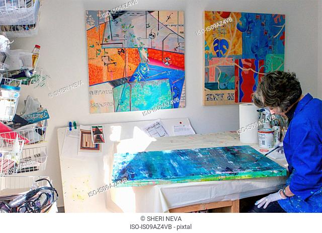 Artist painting canvas