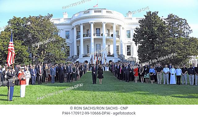 United States President Donald J. Trump and first lady Melania Trump walk out of the White House to lead a moment of silence in remembrance of those lost on...