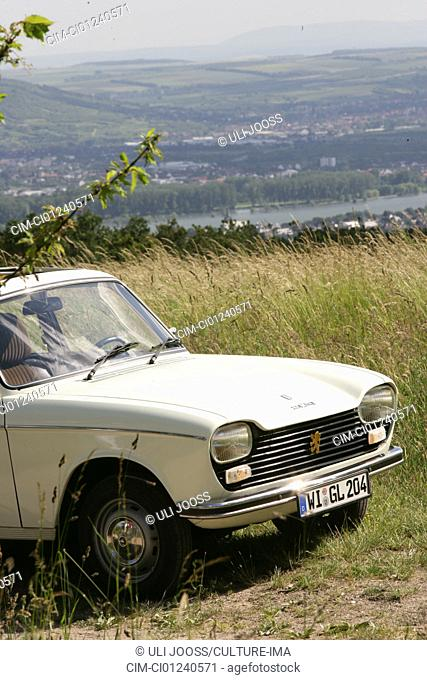 Peugeot 204, vintage car, model year 1965, standing, diagonal front, front view