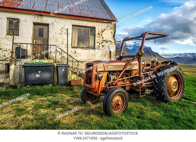 Old tractor in front of decaying farmhouse, Western Iceland