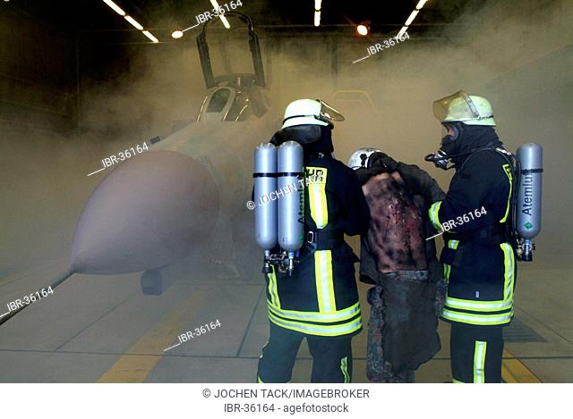 DEU, Federal Republic of Germany, : Rescue exercise of the airport fire service of a german air force base. An explosion took place during an engine test of a...