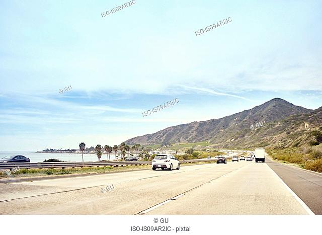Cars on coastal road, Malibu, California, USA