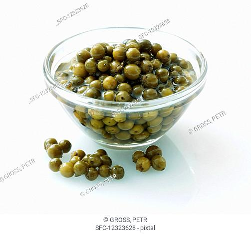 Pickled green peppercorns in a glass bowl