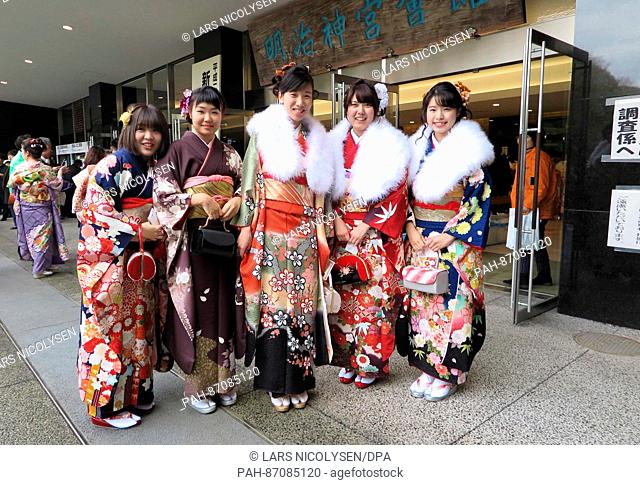 Japanese women wearing kimonos pose in front of the Meiji shrine in Tokyo, Japan, 8 January 2017. Young women who will be 20 years of age between the first of...