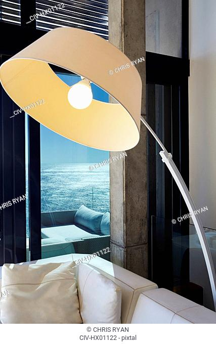 Arc sectional lamp in luxury living room with ocean view