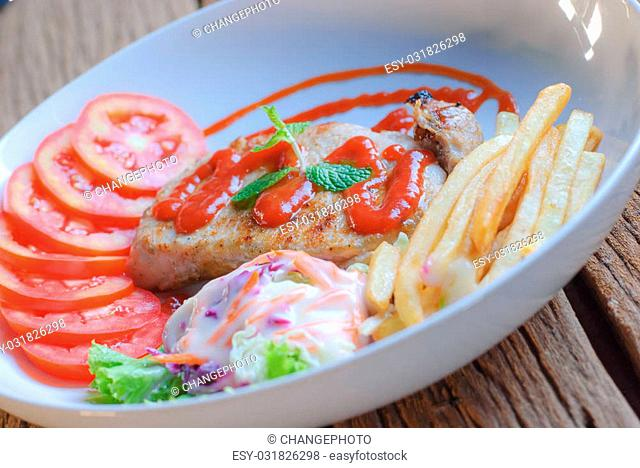 Beautiful pork steak with vegetables and sauce on a plate