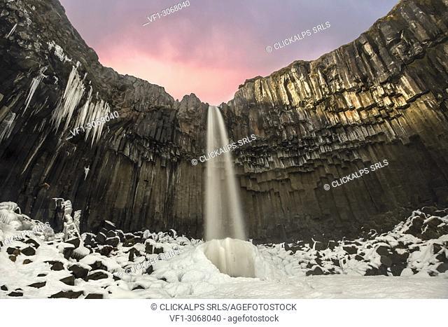Svartifoss waterfall at sunset, Skaftafell National Park, Southern Iceland