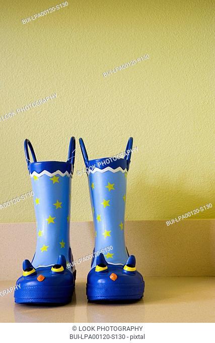Detail of blue rain boots