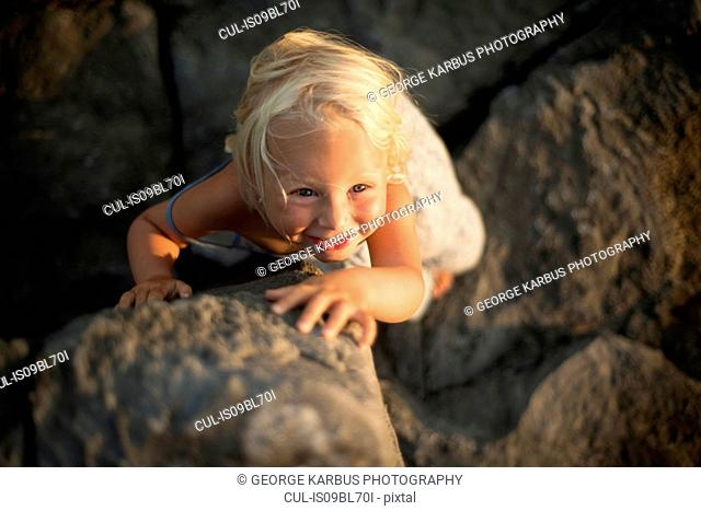 Overhead view of young girl, standing on rocks, Doolin, Clare, Ireland